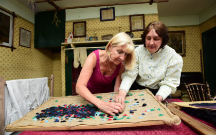 Lady taking part in our Proggy Mat Workshop