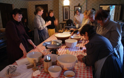 A group takes part in a spot of traditional baking at Beamish's 1940s Farm