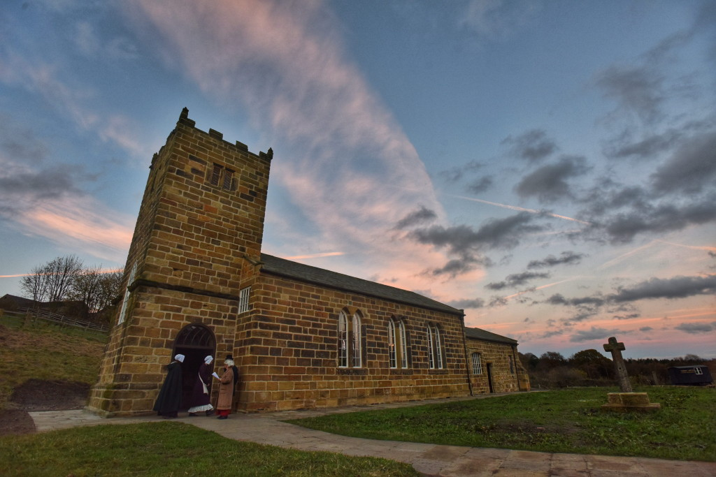 Dated: 12/11/2015 A vandalised medieval church has been taken apart brick by brick and 'lovingly' rebuilt 40 miles away from the place where it originally stood.  Pictured is the official opening of St Helen's Church by Bishop of Durham RT Rev. Paul Butler this evening at Beamish Musuem, County Durham. St Helen's Church in Eston, Middlesbrough was dismantled after it suffered years of vandalism and was painstakingly transported from its former home and rebuilt at Beamish Museum in County Durham.  The decision to transport the church followed years of vandalism, including a fire which destroyed its roofs. The vestry was illegally demolished while stonework and furnishings, such as the font and medieval cross were stolen. The Tudor stained glass was smashed out and in the mid 19th century a cast iron chancel window was taken for scrap. By 1987 St Helen's Church was in a serious state of disrepair and in 1998 Durham County Council and English Heritage gave permission for the grade II listed building to be de-constructed and rebuilt by Beamish. Each individual brick of the church, which is around 900-years-old, was removed from the building and numbered in 1998. Today, the Bishop of Durham,Right Reverend Paul Butler officially opened the restored church in a special candle light parade. #NorthNewsAndPictures/2daymedia