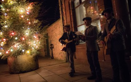 Christmas Evening at Beamish Museum, County Durham. Music and Christmas tree