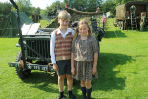 What's on at Beamish in 2020: Dig for Victory - two children stand beside a Second World War vehicle