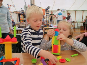 What's on at Beamish in 2020: Crank it Up! - Two children build structures out of colourful bricks.