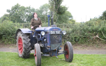 Tractor Gathering at Beamish Museum. A Land Girl drives a tractor at Beamish, The Living Museum of the North
